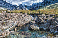 """These are one of many small waterfalls on the isle of Skye. This one part of a larger network of """"Fairy Pools"""" in Glenbrittle. This photo is a bit stylized... similar in toning to what a local artist's watercolor of a similar setting looked like."""