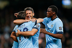 Jose Angel Pozo of Manchester City celebrates with Martin Demichelis and Dedryck Boyata after  scoring a goal to make it 6-0 - Photo mandatory by-line: Rogan Thomson/JMP - 07966 386802 - 24/08/2014 - SPORT - FOOTBALL - Manchester, England - Etihad Stadium - Manchester City v Sheffield Wednesday - Capital One Cup, Third Round.