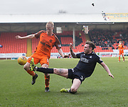 14th April 2018, Tannadice Park, Dundee, Scotland; Scottish Championship football, Dundee United versus Falkirk; Jordan McGhee of Falkirk tackles Thomas Mikkelsen of Dundee United