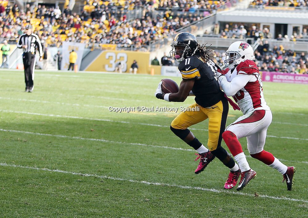 Pittsburgh Steelers wide receiver Markus Wheaton (11) catches a third quarter pass just short of the first down marker while covered by Arizona Cardinals cornerback Jerraud Powers (25) during the 2015 NFL week 6 regular season football game against the Arizona Cardinals on Sunday, Oct. 18, 2015 in Pittsburgh. The Steelers won the game 25-13. (©Paul Anthony Spinelli)