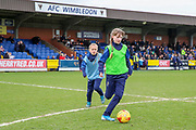 AFC Wimbledon youth team on the pitch at half tiome during the EFL Sky Bet League 1 match between AFC Wimbledon and Bolton Wanderers at the Cherry Red Records Stadium, Kingston, England on 7 March 2020.