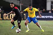 Peru midfielder Yoshimar Yotun (19) and Brazil midfielder Allan (15) battle for the ball during an international friendly soccer match, Tuesday, Sept. 10, 2019, in Los Angeles. Peru defeated Brazil 1-0.