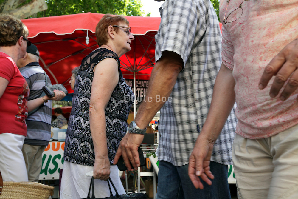 elderly people at an outdoors regional farmers market