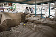 Organic cotton after it's been cut in to shape at Pratibha Syntax factory, where organic cotton is being used to make clothes, Indore, India.