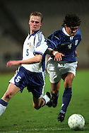 07.10.2000, Olympic Stadium, Athens, Greece. .FIFA World Cup Qualifying match, Greece v Finland. .Hannu Tihinen (Finland) v Georgios Amanatidis (Greece).©Juha Tamminen
