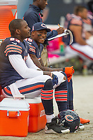06 October 2013: Tight end (83) Martellus Bennett and wide receiver (15) Brandon Marshall of the Chicago Bears sit on the sideline late in the game against the New Orleans Saints during the second half of the Saints 26-18 victory over the Bears in an NFL Game at Soldier Field in Chicago, IL.