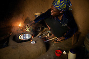 Alice Mogire prepares an omlette in her kitchen...Merlin has been teaching people the importance of a balanced diet and also how to grow a variety of crops.
