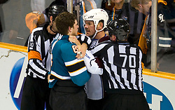 April 22, 2010; San Jose, CA, USA; Colorado Avalanche defenseman Scott Hannan (second from right) stares at San Jose Sharks left wing Jamie McGinn (second from left) after fighting during the second period of game five in the first round of the 2010 Stanley Cup Playoffs at HP Pavilion.  San Jose defeated Colorado 5-0. Mandatory Credit: Jason O. Watson / US PRESSWIRE