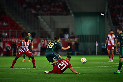 September 20, 2018 - Piraeus, Attiki, Greece - Kostas Tsimikas (no 21) of Olympiacos did foul to Andres Guardado (no 18) of Real Betis. (Credit Image: © Dimitrios Karvountzis/Pacific Press via ZUMA Wire)