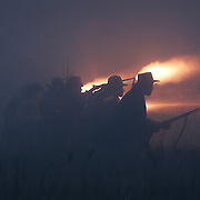 Confederates fire a volley at a Federal line during the sunrise battle, a reenactment of the Battle of Pottsville, during the weekend celebration of the Battle of Perryville, which serves as the national Civil War reenactment for 2006, at the Perryville Battlefield in Perryville, Ky. on Oct. 7, 2006. David Stephenson/Staff