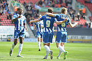 Wigan Striker Will Grigg celebrates with team mates after his scores  during the Sky Bet League 1 match between Wigan Athletic and Southend United at the DW Stadium, Wigan, England on 23 April 2016. Photo by John Marfleet.