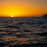 Sailboat navigating into the sunset. Cabo San Lucas, Baja California Sur. Mexico.