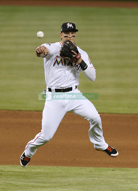 June 21, 2017 - Miami, FL, USA - Miami Marlins third baseman Derek Dietrich throws to first to put out Washington Nationals pitcher Max Scherzer during the sixth inning on Wednesday, June 21, 2017 at Marlins Park in Miami, Fla. (Credit Image: © David Santiago/TNS via ZUMA Wire)