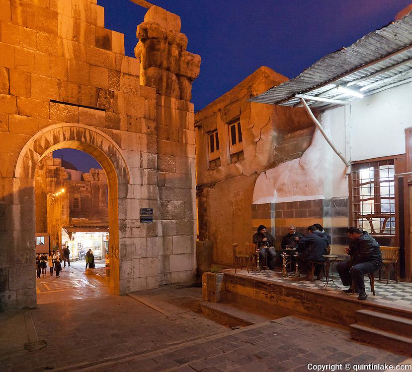 Roman arch east of Umayyad Mosque and sheesha cafe, Damascus, Syria