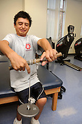 University of Arizona student Christian Rodriguez works out at the campus Disability Resource Center.  Rodriguez is on the university's wheelchair basketball team in Tucson, Arizona, USA.