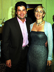 MR TIM MOUFARRIGE and his wife TV presenter TANIA BRYER, at a party in London on 6th October 1999.MXG 58