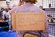 15 MAY 2009 -- PHOENIX, AZ: A convention goer uses his back as a billboard to advertise gun parts he has for sale. More than 60,000 people are expected to attend the NRA convention and annual meeting, which is being held at the Phoenix Convention Center through Sunday. This is the 138th annual meeting of the National Rifle Association.  Photo by Jack Kurtz