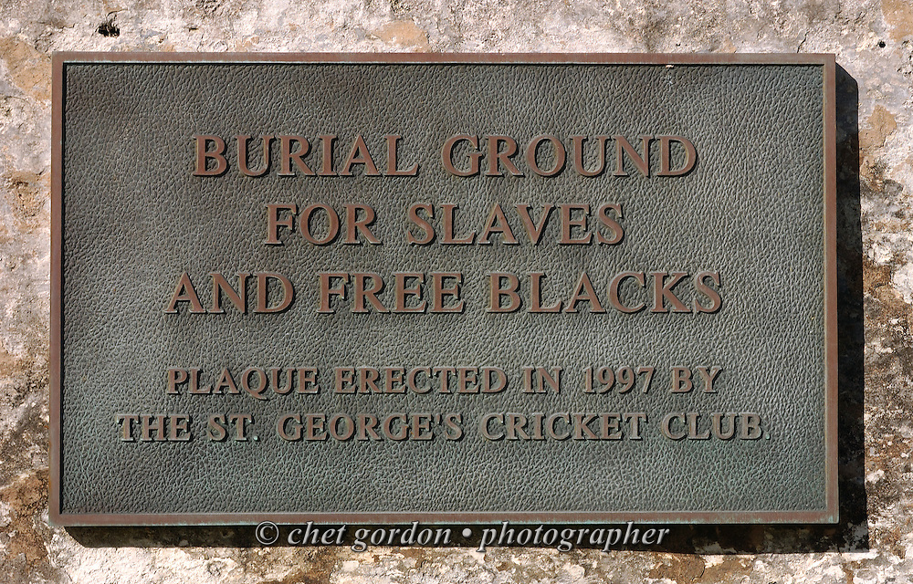 Plaque at the entrance to the segregated burial ground for Slaves and Free Blacks in the cemetery of St. Peter's Church in St. George, Bermuda on Sunday, October 10, 2010. Located in the historic town of St George, St Peter's Church is believed to be the oldest continually used Anglican church in the Western hemisphere. The original church was built from Bermuda cedar with a palmetto-thatch roof in 1612. Most of the present structure dates from 1713 but some features, such as the steeple, were later additions. The first Bermuda Parliament met here in 1620, making it the 3rd oldest parliament in the world.
