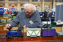 © Licensed to London News Pictures. 17/01/2020. London, UK. A member of G-Scale Society tends to a model train at the London Model Engineering Exhibition at Alexandra Palace as enthusiasts and hobbyists visit the annual show in north London. Clubs and societies are exhibiting spectrum of modelling from traditional model engineering, steam locomotives and traction engines through to the more modern gadgets including trucks, boats, aeroplanes and helicopters with nearly 2,000 models constructed by their members. Photo credit: Dinendra Haria/LNP