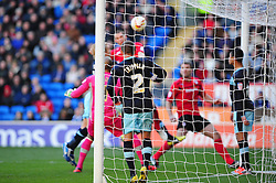 Cardiff City's Matthew Connolly scores from a corner - Photo mandatory by-line: Dougie Allward/Josephmeredith.com  - Tel: Mobile:07966 386802 27/10/2012 - SPORT - FOOTBALL - Championship -  Cardiff  - New Cardiff City stadium - Cardiff City V Burnley
