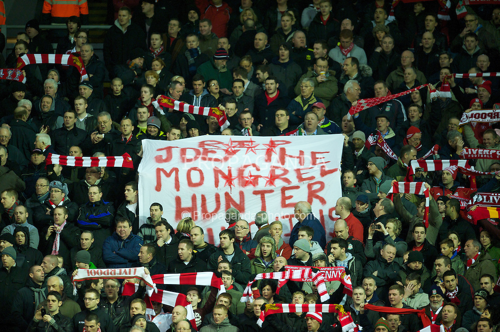 LIVERPOOL, ENGLAND - Wednesday, January 26, 2011: Liverpool's supporters with a banner 'RIP Joey the Mongrel Hunter' during the Premiership match against Fulham at Anfield. (Photo by: David Rawcliffe/Propaganda)