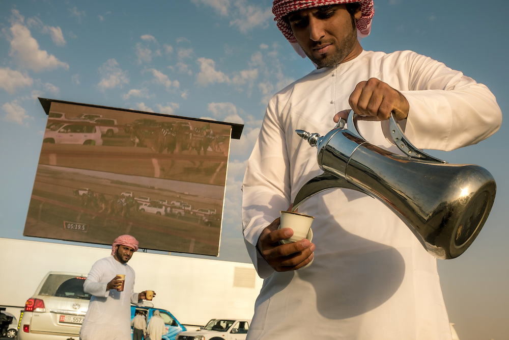 Local spectators and visitors can watch the race on an outdoor screen from their SUVs, while enjoying some arabic tea.