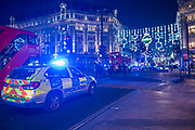 Armed police flood the Oxford Circus area after an incident caused the station to be cleared.