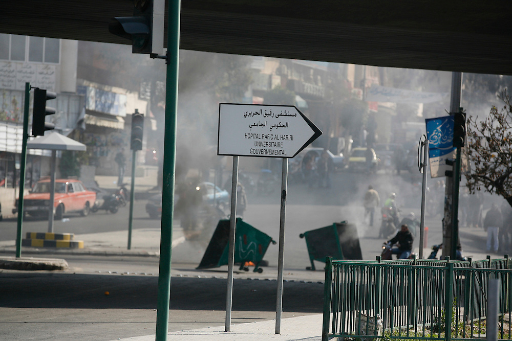 """Small protests broke out in various areas around Lebanon after consultations were held on Monday with member of parliament, Najib Mikati, appearing as the front runner to replace Saad Hariri. Mikati is the choice of the March 8 coalition, which includes the Lebanese resistance and political movement Hizballah. March 8 collapsed the Lebanese government over a week ago as the UN tribunal investigating the killing of former Prime Minsiter, Rafiq Hariri, Saad's father, gets set to release indictments which are expected to target members of Hizballah. In Beirut a small protest was held at the grave of Rafiq Hariri, and elsewhere tires were burned shutting down roads by Saad Hariri's supporters.///Around 100 supporters of former prime minister Saad Hariri gathered outside the grave of Rafiq Hariri, Saad's father, in downtown Beirut. Many chanted against Iran, a supporter of Hizballah and the March 8 movement. .Supporters of former Prime Minister Saad Hariri called for a """"day of rage"""" across Lebanon on Tuesday, 25 January. In Sunni Muslim areas around the country protestors took to the streets to protest against the selection of Najib Mikati as Lebanon's new prime minister. Near Beirut's main Cola junction, young men from the Tariq al-Jadide neighborhood set fires to trash bins and tires, while the Lebanese army intervened putting out fires. The situation remains tense in Lebanon as supporters of Hariri's March 14 coalition protest as the former opposition March 8 coalition (which includes Hizballah) becoms the new majority in government."""