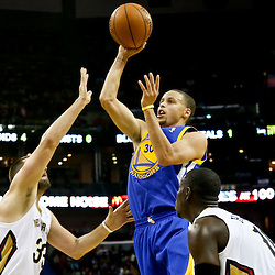 Nov 26, 2013; New Orleans, LA, USA; Golden State Warriors point guard Stephen Curry (30) shoots over New Orleans Pelicans power forward Ryan Anderson (33) and point guard Jrue Holiday (11) during the second half of a game at New Orleans Arena. The Warriors defeated the Pelicans 102-101. Mandatory Credit: Derick E. Hingle-USA TODAY Sports