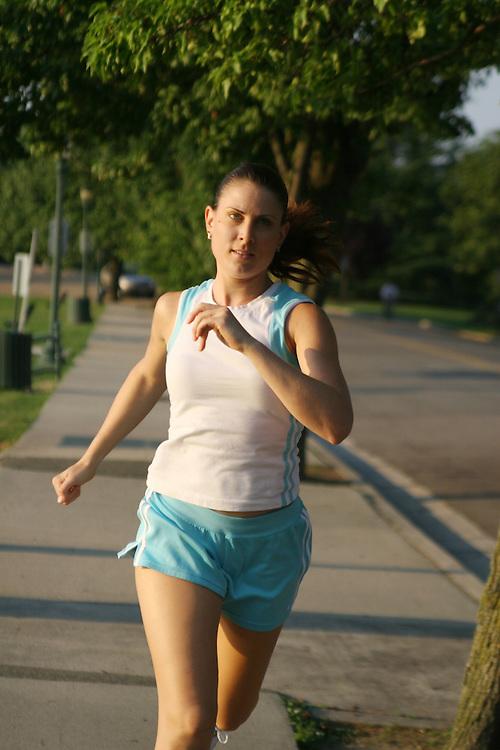 woman running on sidewalk