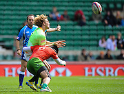 LONDON, ENGLAND - Saturday 10 May 2014, Werner Kok of South Africa is tackled by Tomas Noronha of Portugal during the match between South Africa and Portugal at the Marriott London Sevens rugby tournament being held at Twickenham Rugby Stadium in London as part of the HSBC Sevens World Series.<br /> Photo by Roger Sedres/ImageSA