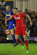 Adam Barrett of AFC Wimbledon  and Rickie Lambert of Liverpool during the FA Cup match at the Cherry Red Records Stadium, Kingston<br /> Picture by David Horn/Focus Images Ltd +44 7545 970036<br /> 05/01/2015