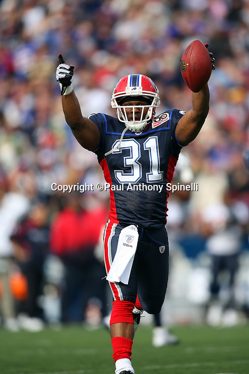 Buffalo Bills cornerback Jairus Byrd (31) runs with the ball after intercepting the second of two passes in the first quarter during the NFL football game against the Houston Texans, November 1, 2009 in Orchard Park, New York. The Texans won the game 31-10. (©Paul Anthony Spinelli)