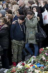 April 9, 2017 - Stockholm, Sweden - People grieve during a vigil in Sergels Torg Plaza, two days after a terror attack on a busy pedestrian street killed four people. (Credit Image: © Aftonbladet/IBL via ZUMA Wire)