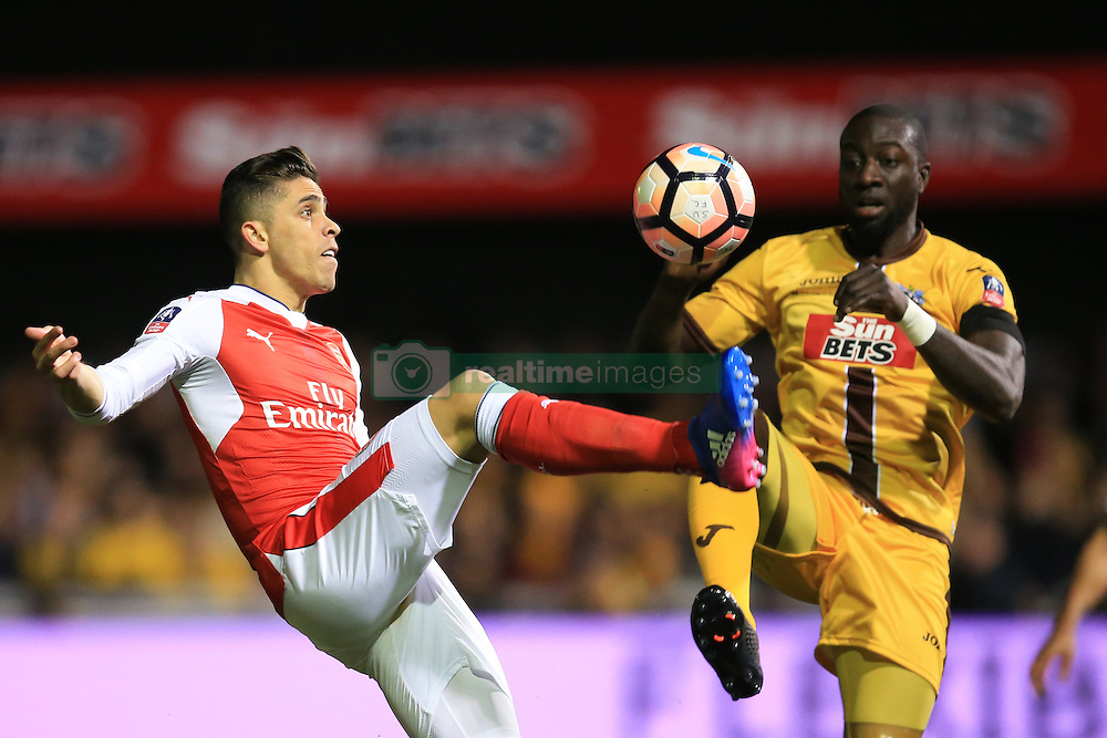 20 February 2017 - The FA Cup - (5th Round) - Sutton United v Arsenal - Gabriel Paulista of Arsenal in action with Kevin Amankwaah of Sutton United - Photo: Marc Atkins / Offside.