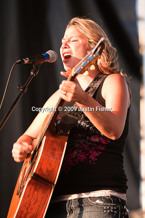 Angie Stevens and the Beautiful Wreck, in support of Melissa Etheridge play the main stage on Mountain Avenue at Bohemian Nights at the New West Fest, Fort Collins CO, August 2009