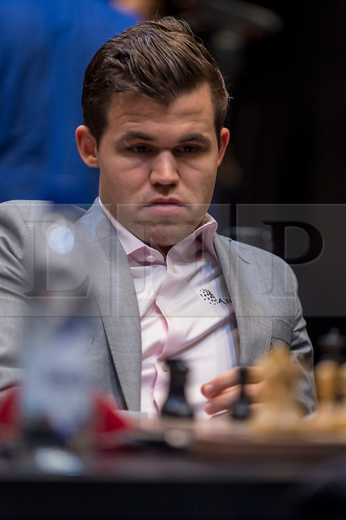 © Licensed to London News Pictures. 26/11/2018. LONDON, UK.  London, UK.  26 November 2018.  Magnus Carlsen (pictured) of Norway competes against Fabiano Caruana (not pictured) of the United States in the 12th game of the World Chess Championship taking place at The College in Holborn.  The 12 game match is currently tied after 11 draws.  Photo credit: Stephen Chung/LNP