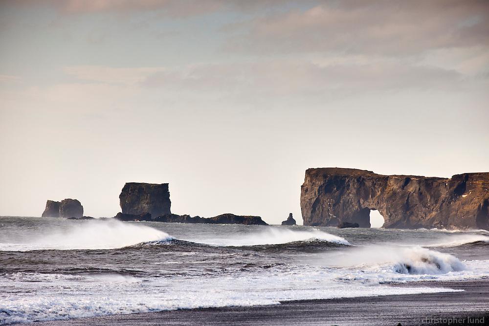 Reynisfjara black sand beach, south shore Iceland. Dyrhólaey in background.