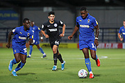 AFC Wimbledon attacker Michael Folivi (17) and AFC Wimbledon defender Paul Osew (37) on the attack during the EFL Trophy (Leasing.com) match between AFC Wimbledon and U23 Brighton and Hove Albion at the Cherry Red Records Stadium, Kingston, England on 3 September 2019.