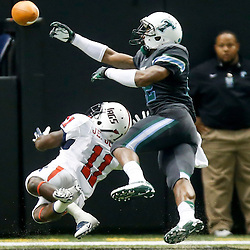 Sep 7, 2013; New Orleans, LA, USA; Tulane Green Wave cornerback Jordan Sullen (22) breaks up a pass intended for South Alabama Jaguars wide receiver Jeremé Jones (11)  during the second quarter of a game at the Mercedes-Benz Superdome. Mandatory Credit: Derick E. Hingle-USA TODAY Sports