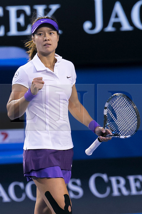 © Licensed to London News Pictures. 26/01/2013. Melbourne Park, Australia. Li Na fist pumps in celebration after winning a point during the Womens Final between Victoria Azarenka and Li Na of the Australian Open. Photo credit : Asanka Brendon Ratnayake/LNP