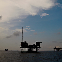 Oil production platforms are seen in the Gulf of Mexico off the coast of Louisiana, U.S., on Thursday, July 15, 2010. Photographer: Derick E. Hingle/Bloomberg