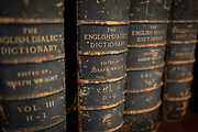 Antiquarian copies of the English Dialect Dictionary line the shelves in the Lee Library of the British Academy, on 17th September 2017, at 10-12 Carlton House Terrace, in London, England. The English Dialect Dictionary (EDD) is a dictionary of English dialects compiled by Joseph Wright (1855–1930). The English Dialect Dictionary, being the complete vocabulary of all dialect words still in use, or known to have been in use during the last two hundred years; founded on the publications of the English Dialect Society and on a large amount of material never before printed was published by Oxford University Press in 6 volumes between 1898 and 1905. Its compilation and printing was funded privately by Joseph Wright, a self-taught philologist at the University of Oxford.