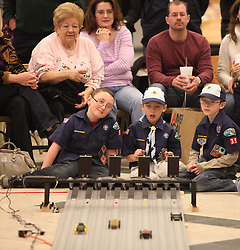 March 26, 2011: Cub scouts watch their pinewood derby cars go down the track during the West Virginia State Pinewood Derby held at the Medowbrook Mall in Bridgeport.  (Photo by: Ben Queen)