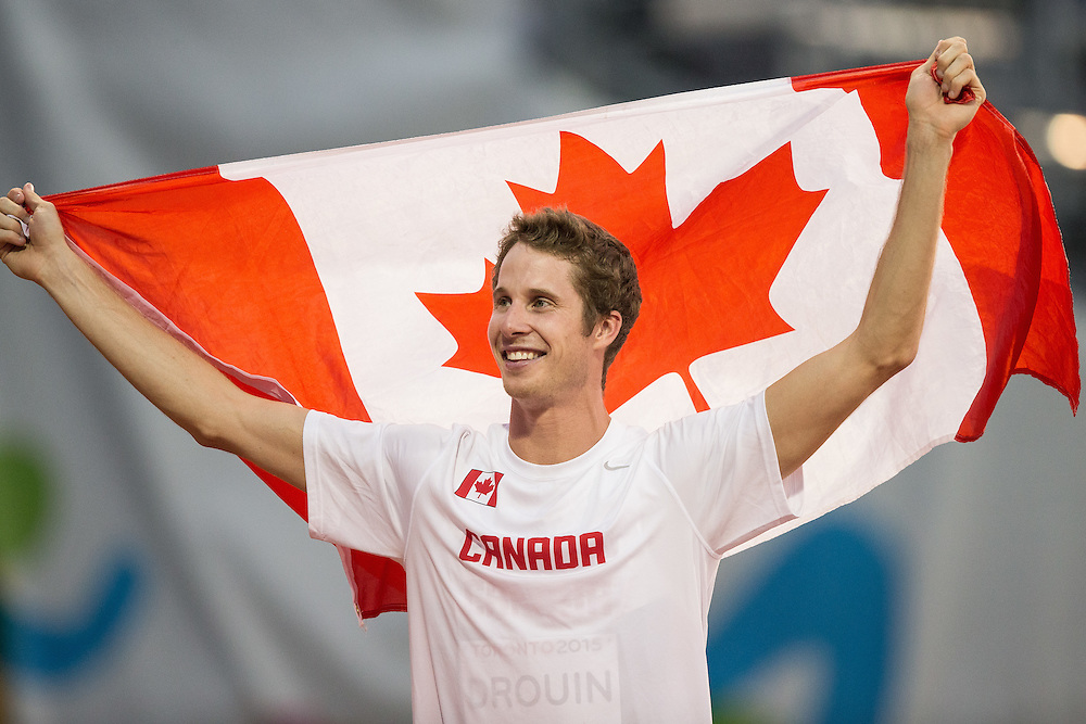 Derek Drouin of Canada celebrates his gold medal win in the men's high jump at the 2015 Pan American Games at CIBC Athletics Stadium in Toronto, Canada, July 25,  2015.  AFP PHOTO/GEOFF ROBINS