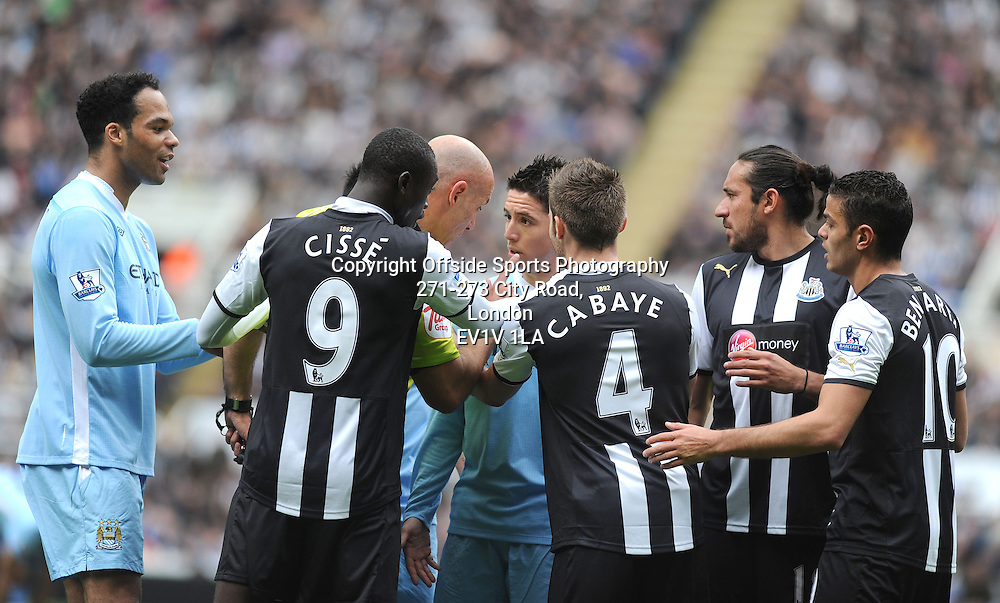 06/05/2012 - Barclays Premier League Football - 2011-2012 - Newcastle United v Manchester City - Referee Howard Webb has a word with Samir Nasri of City. - Photo: Charlie Crowhurst / Offside.