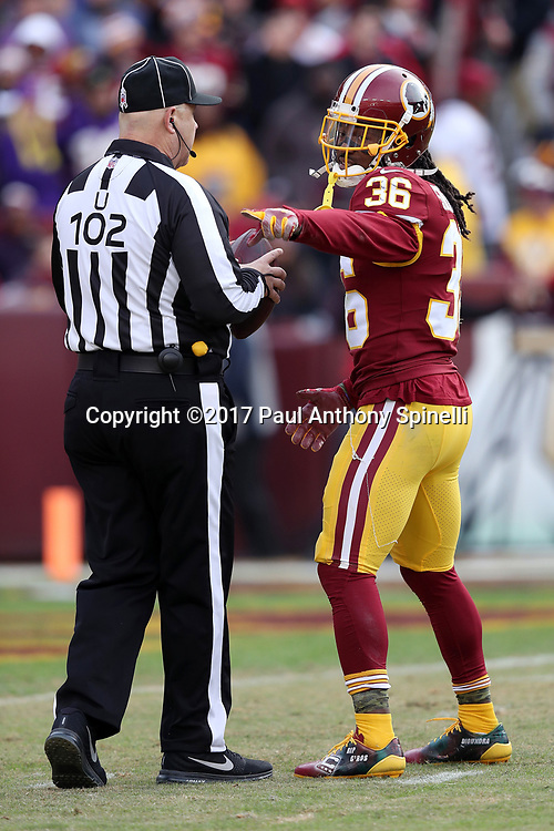 Washington Redskins free safety D.J. Swearinger (36) points as he complains to umpire Bruce Stritesky (102) after intercepting his second pass of the day and running it back 31 yards to the Minnesota Vikings 2 yard line during the 2017 NFL week 10 regular season football game against the Minnesota Vikings, Sunday, Nov. 12, 2017 in Landover, Md. The Vikings won the game 38-30. (©Paul Anthony Spinelli)