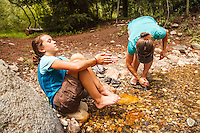 Washing their feet after the hike down from Hyndman Basin, Pioneer Mountains, Idaho.