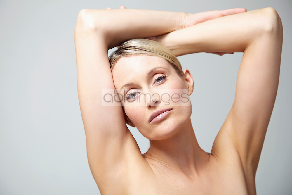 Woman with Arms Crossed above Head