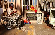 TIJUANA, MEXICO.  A man in wheelchair pauses near the US / Mexico border in Tijuana, Mexico on Tuesday, July 27, 2004. Tijuana, Mexico borders the US town of San Ysidro, CA.  © CHET GORDON / THE IMAGE WORKS